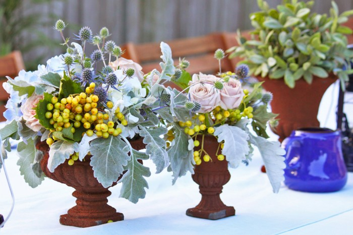Flowers in rustic urns